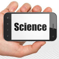 Science concept: Hand Holding Smartphone with Science on display