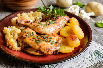 Roasted chicken legs with potato and cauliflower
