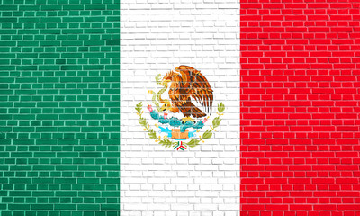 Flag of Mexico on brick wall texture background