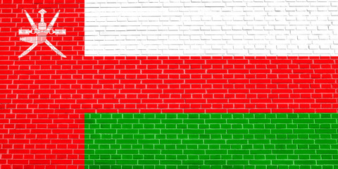 Flag of Oman on brick wall texture background