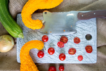 Small red cherry tomatoes spill out of on  old wooden table in r
