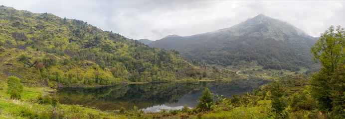 panorama of a small mountain lake in the pyrenees
