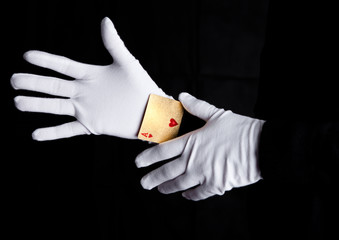 Playing cards trick with ace hands with gloves