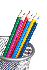colored pencils in basket