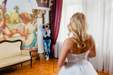 Wedding photographer is taking pictures the bride
