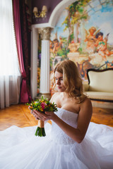 Bride portrait in beautiful interior with bridal bouquet
