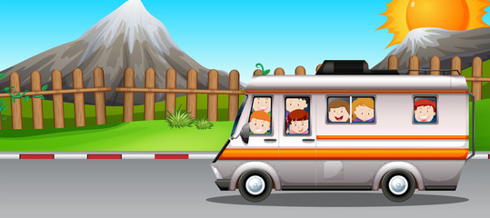 Children riding on camper van