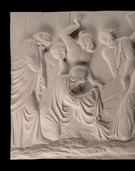 Gypsum dimensional picture with biblical scenes and the Last Supper Way to Calvary. Christian plaster relief