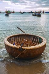 Vietnamese round boat, beach, sunset