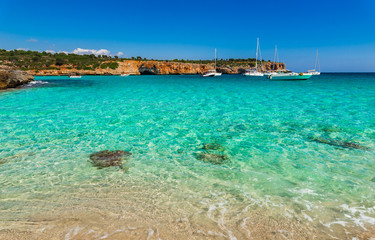 Mediterranean Sea coastline beach bay with boats at Cala Varques Majorca Spain