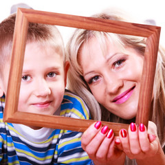 Mother and son play with empty frame.
