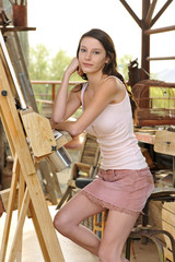 Beautiful Young Model Sitting at Artists Easel on Arizona Ranch