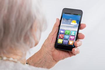Close-up Of Senior Woman Using Smartphone