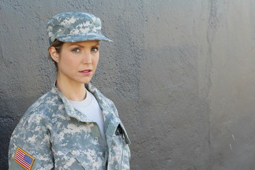 Portrait of serious female airman against dark background