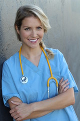 Portrait of cheerful female doctor at office