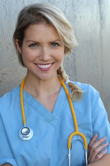 Young beautiful successful female doctor with stethoscope - portrait