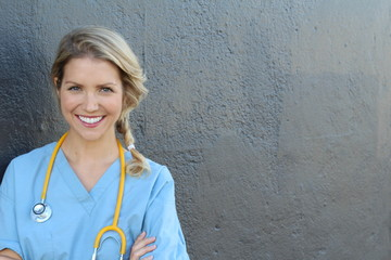 Beautiful young doctor with stethoscope and copy space for text
