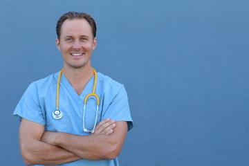 Doctor with stethoscope standing , crossed arms, isolated on blue background