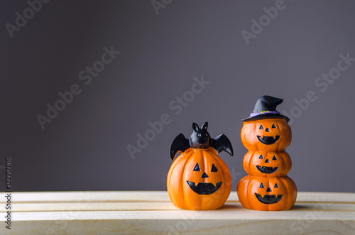 Happy Halloween, Two Pumpkin on table wood with gray wall background, halloween concept. Copy space.
