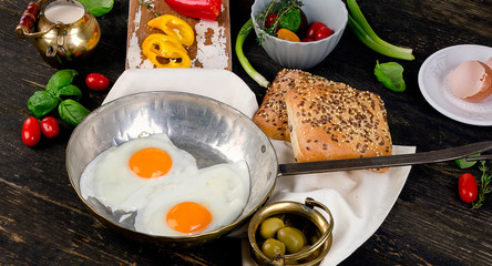 Fried eggs on  rustic wooden table