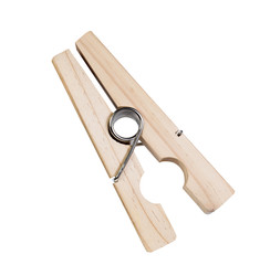 Large wooden clothespin. Isolated over white