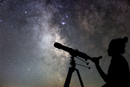 Woman and night sky. Watching the stars Woman with telescope.