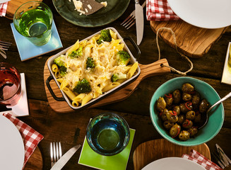 Pasta with broccoli and cheese in dish on table