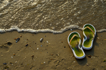 slippers and sea wave