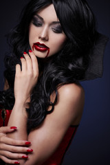 Beauty vamp with blood on the mouth