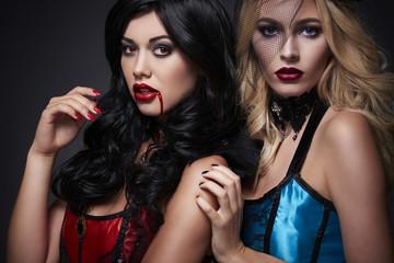 Two beautiful Halloween women in the studio