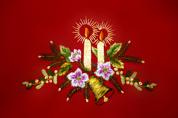 Christmas with burning candles,bell and flowers,embroidered satin stitch on red background