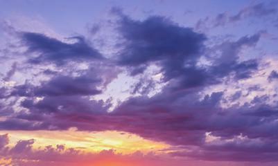 Beautiful sunset through the evening cloudy sky/Beautiful sunset through the evening cloudy sky