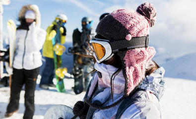 woman with snowboard outdoors