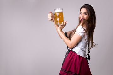 Brunette girl in traditional bavarian costume in Germany