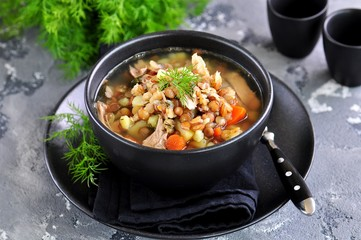 Lentil soup with chicken meat, potatoes, carrots and dill.