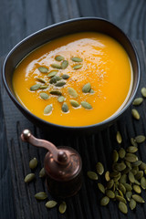 Close-up of pumpkin cream-soup topped with pumpkin seeds