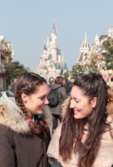 beautiful sisters have fun in luna park