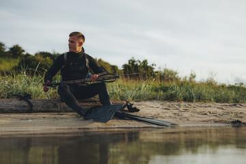 Spear fisherman at sea shore