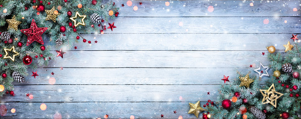 Christmas Fir Tree With Baubles And Snowflakes On Wooden Background