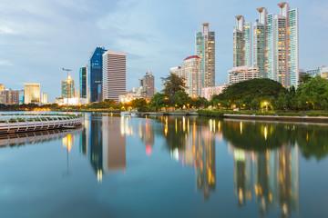 Foto op Aluminium Kuala Lumpur Reflection of Office building downtown in public park, Bangkok Thailand