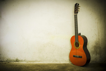 Guitar on background of a wall