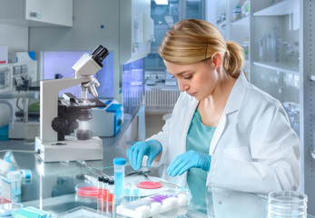 Young female scientist works in modern laboratory