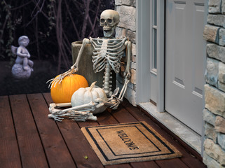 Skeleton and pumpkins in doorway for Halloween