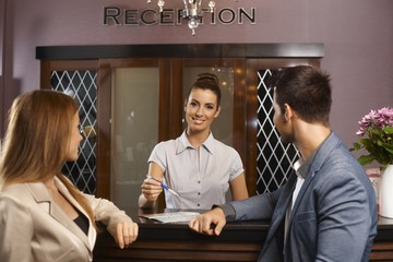 Portrait of happy receptionist at hotel