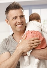 Closeup photo of happy father and baby girl