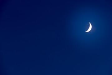 Moon on a dark blue sky.