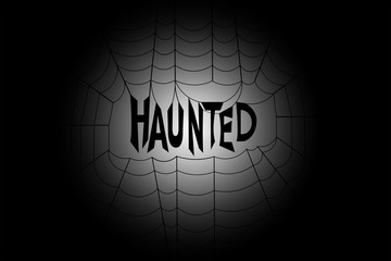 Word haunted hanging in the middle of a spider web, against spooky gradient black and white gradient background
