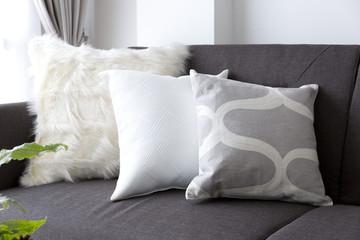 white soft cushion on sofa
