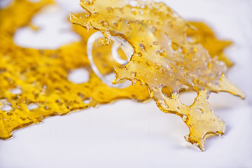 annabis oil concentrate aka shatter with glass rig