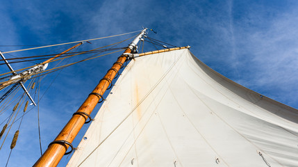 Sailboat mast against a blue sky
